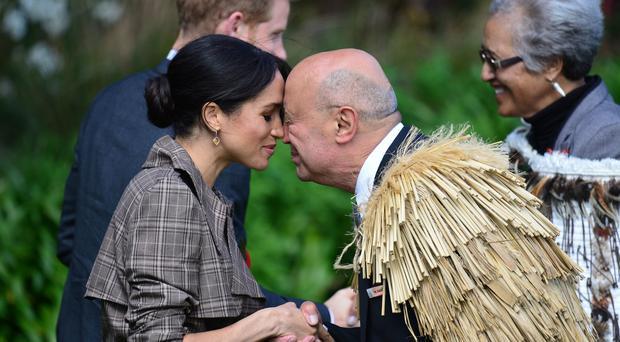 The Duchess of Sussex receives a hongi, a traditional Maori greeting, at an official welcome ceremony at Government House in Wellington (Dominic Lipinski/PA)