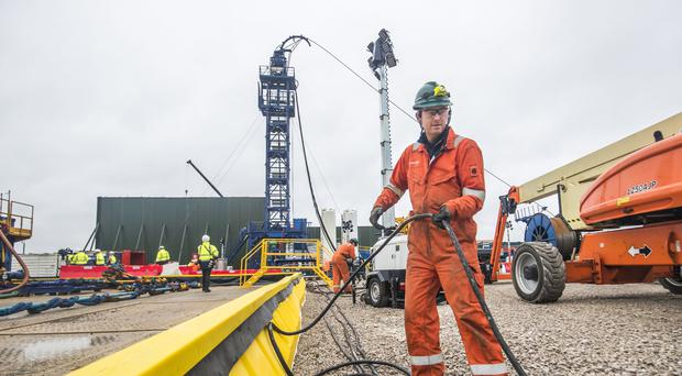 A worker at the Cuadrilla fracking site in Preston New Road (Danny LAwson/PA)
