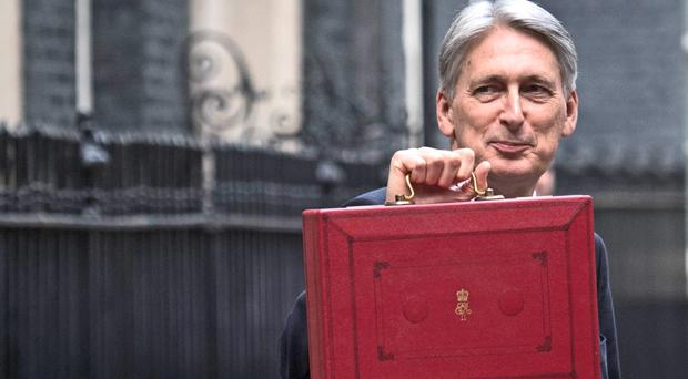 Chancellor Philip Hammond holding his red ministerial box outside 11 Downing Street, London, before heading to the House of Commons to deliver his Budget (Stefan Rousseau/PA)