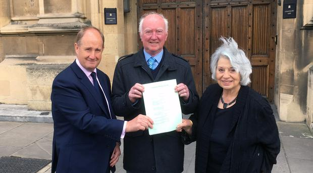 Kevin Hollinrake MP, Peter Lawrence (centre) and Baroness Hamwee holding a copy of Claudia's Law (PA)