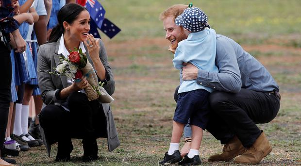 The Duke and Duchess of Sussex meet Luke Vincent, five, after arriving at Dubbo airport in Australia (Phil Noble/PA)