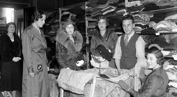 The Duchess of York (the Queen Mother) with Lady Reading (l) watching bales being packed with articles of clothing.