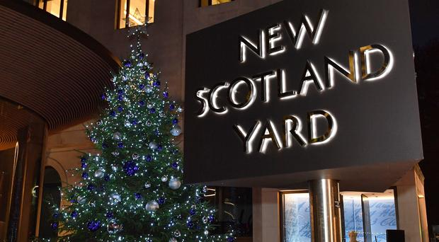 The Christmas tree for the Metropolitan Police Christmas tree appeal outside New Scotland Yard (John Stillwell/PA)
