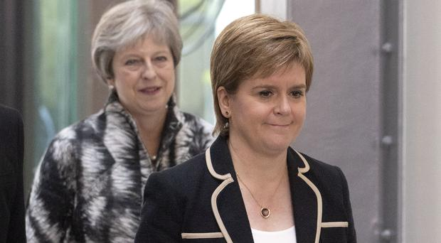 Nicola Sturgeon said she would not support a deal which does not offer membership of the single market and customs union (Jane Barlow/PA)
