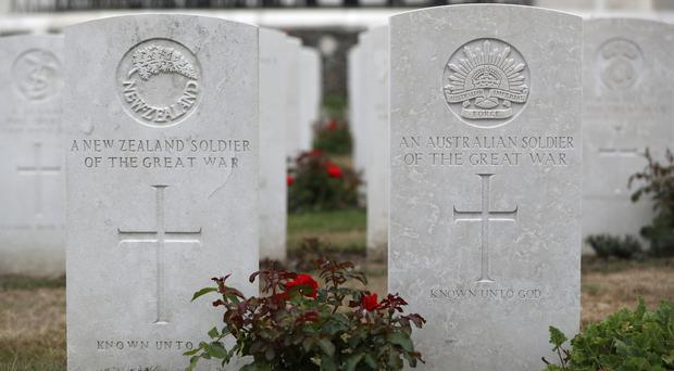 The grave stones of an unknown Australian and and unknown New Zealand soldier in Tyne Cot Commonwealth War Graves Cemetery, near to Ypres in Belgium (Andrew Matthews/PA)