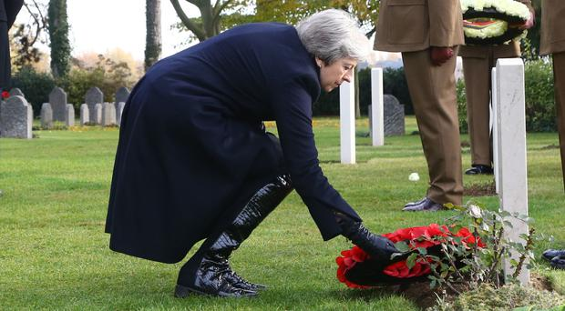 Prime Minister Theresa May at the St Symphorien Military Cemetery in Mons (Gareth Fuller/PA)