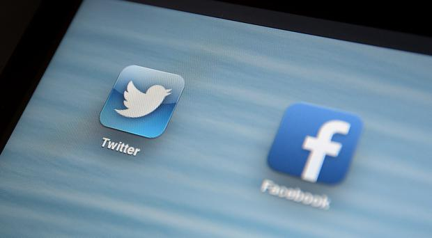 File photo dated 30/07/13 of the Twitter (left) and Facebook app icons, as a study finds that excessive use of social media is associated with a subsequent increase in narcissism.