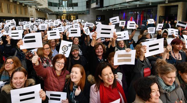 (John Stillwell/PA Archive/PA Images) Viral photo from International Women's Day shows campaigners appealing for equal pay