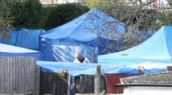 Police forensics tents in a back garden in Sutton Coldfield, West Midlands (Peter Byrne/PA)