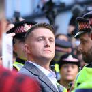 Tommy Robinson, whose real name is Stephen Yaxley-Lennon, denied his visa application had been rejected (Yui Mok/PA)
