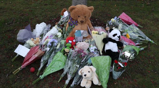 Floral tributes left near a property in Coupar Angus where Kane Morris died (Andrew Milligan/PA)