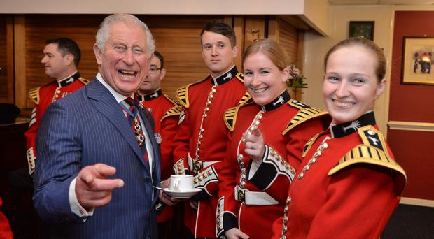 The Prince of Wales shares a joke with members of the Welsh Guards band (John Stilwell/PA)