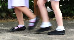 School pupils in Scotland are assessed in P1, P4, P7 and S3 (Ian West/PA)