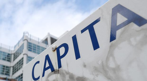 File photo dated 31/01/18 of a Capita sign outside their offices in Bournemouth, Dorset, as more details of their cervical cancer screening blunder emerge.