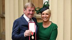 Liverpool legend Sir Kenny Dalglish with his wife after being knighted at an investiture ceremony at Buckingham Palace (Jonathan Brady/PA)