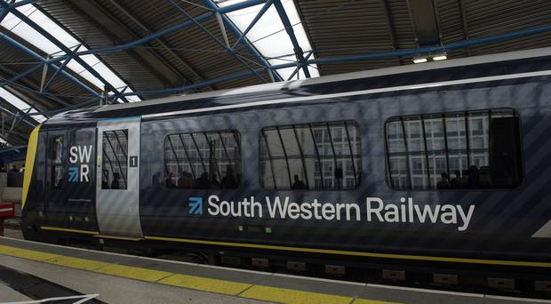 South Western Railway services were disrupted by over-running engineering works (Victoria Jones/PA)