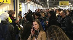 Passengers queuing at Clapham Junction railway station (Hayley Lancefield)