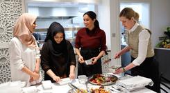 Meghan, Duchess of Sussex, with chef Clare Smyth (far right) as they visit the Hubb Community Kitchen
