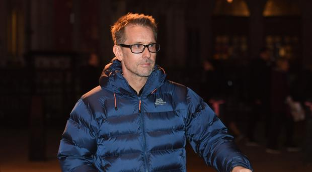 Retired Swedish racing driver Kenny Brack leaves the Family Division of the High Court in London (Stefan Rousseau/PA)