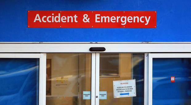 A view of an entrance to an Accident and Emergency Department at a hospital in Kent, as research finds that more than 8,200 women in England and Wales could have survived their heart attacks had they been given the same quality of treatment as men.
