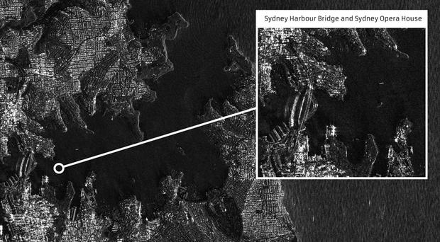 An image of Sydney Harbour at night captured in the debut images by the first all-British radar satellite (SSTL/PA)