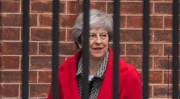 Theresa May insisted that as far as she was concerned, Brexit would go ahead next year as planned (Dominic Lipinski/PA)