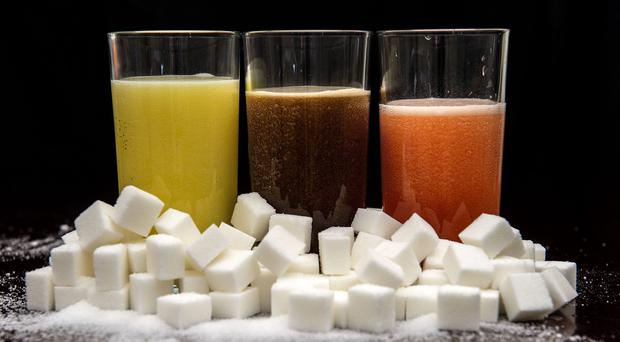 The Scottish Government is being urged to limit multi-buy deals on sugary soft drinks (Anthony devlin/PA)