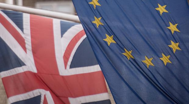 The EU and Union flags as an advocate general from the European Court of Justice publishes his opinion that the UK can unilaterally revoke its withdrawal from the EU (Stefan Rousseau/PA)
