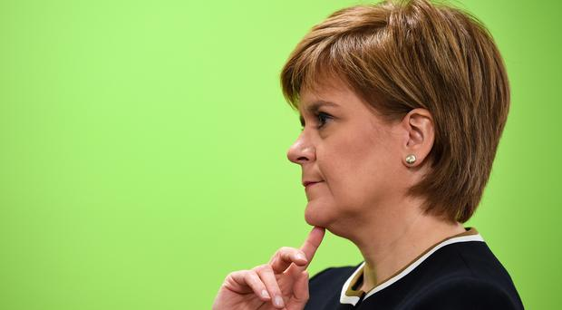Nicola Sturgeon said Scotland will continue to raise its ambition in tackling climate change (Jeff J Mitchell/PA)