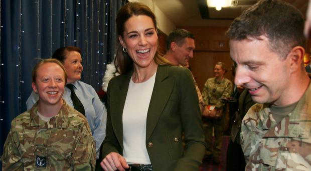 The Duke and Duchess of Cambridge meet members of 31 SQN and other operational personnel in a hangar at RAF Akrotiri in Cyprus