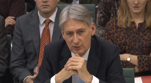 Philip Hammond giving evidence to the Treasury Select Committee (PA)