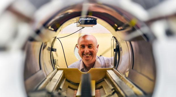 "Undated handout photo issued by the University of Aberdeen of Professor David Lurie looking through a new scanner which has been likened to ""100 MRIs in one""."