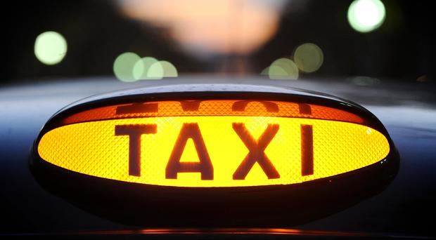 The number of taxi licences in Northern Ireland has fallen by 10% in the past year with the total number of drivers near an all-time low. (Dominic Lipinski/PA)