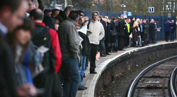 More than one in seven trains were late in the 12 months to the end of September (Gareth Fuller/PA)