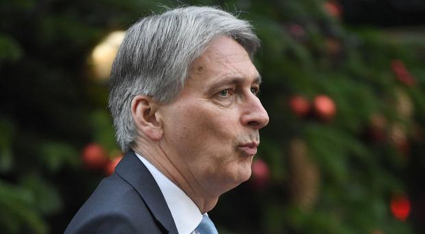 Chancellor of the Exchequer Philip Hammond arrives in Downing Street, London, for a meeting of the Cabinet.