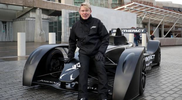 Former Formula 1 champion Mika Hakkinen with the Johnnie Walker Caparo T1 supercar, during the launch of a responsible drinking campaign at the Scottish Parliament in Edinburgh (Jane Barlow/PA)