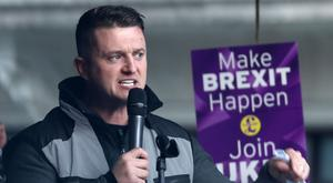 Tommy Robinson addresses the rally (Gareth Fuller/PA)