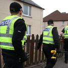 Police executed searches at two properties in Midlothian (Andrew Milligan/PA)