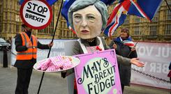 A demonstrator dressed as Theresa May sells Brexit Fudge in Old Palace Yard, Westminster.