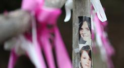 Photographs of Nicola Fellows and Karen Hadaway near their memorial tree in Wild Park in Brighton, East Sussex, where their bodies where found (PA Wire)