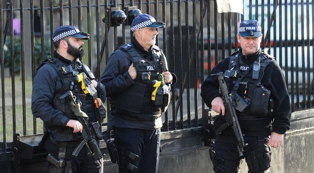 Armed police following an incident at the Palace of Westminster (Kirsty O'Connor/PA)