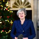 Prime Minister Theresa May makes a statement in 10 Downing Street after she survived an attempt by Tory MPs to oust her with a vote of no confidence (Victoria Jones /PA)