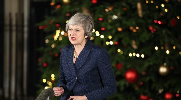 Prime Minister Theresa May makes a statement in 10 Downing Street, London, after she survived an attempt by Conservative MPs to oust her with a vote of no confidence (Andrew Matthews/PA)