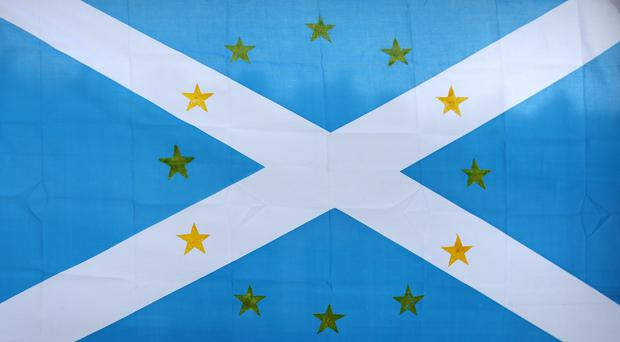 A Saltire flag decorated with stars representing the European Union