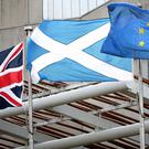 A Union flag, a Saltire and the EU flag, as the Supreme Court ruled that parts of a Brexit Bill passed by the Scottish Government would be outside its legislative powers (Jane Barlow/PA)