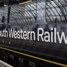 RMT workers at South Western Railway have announced new strike dates (Victoria Jones/PA)