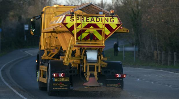 A gritting lorry from Royal Windsor and Maidenhead Borough Council grits a road near Slough (Steve Parsons/PA)