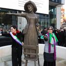 Sculptor Hazel Reeves (left) at the unveiling of her Emmeline Pankhurst statue, with Helen Pankhurst (Peter Byrne/PA)