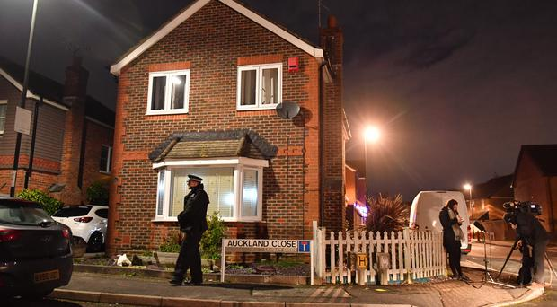 A police officer remains on duty outside a home in Auckland Close, Crawley, West Sussex which has been searched in connection with the drone incident at Gatwick airport (Dominic Lipinski/PA)