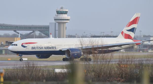 A British Airways plane lands at Gatwick airport which had been closed (John Stillwell/PA)